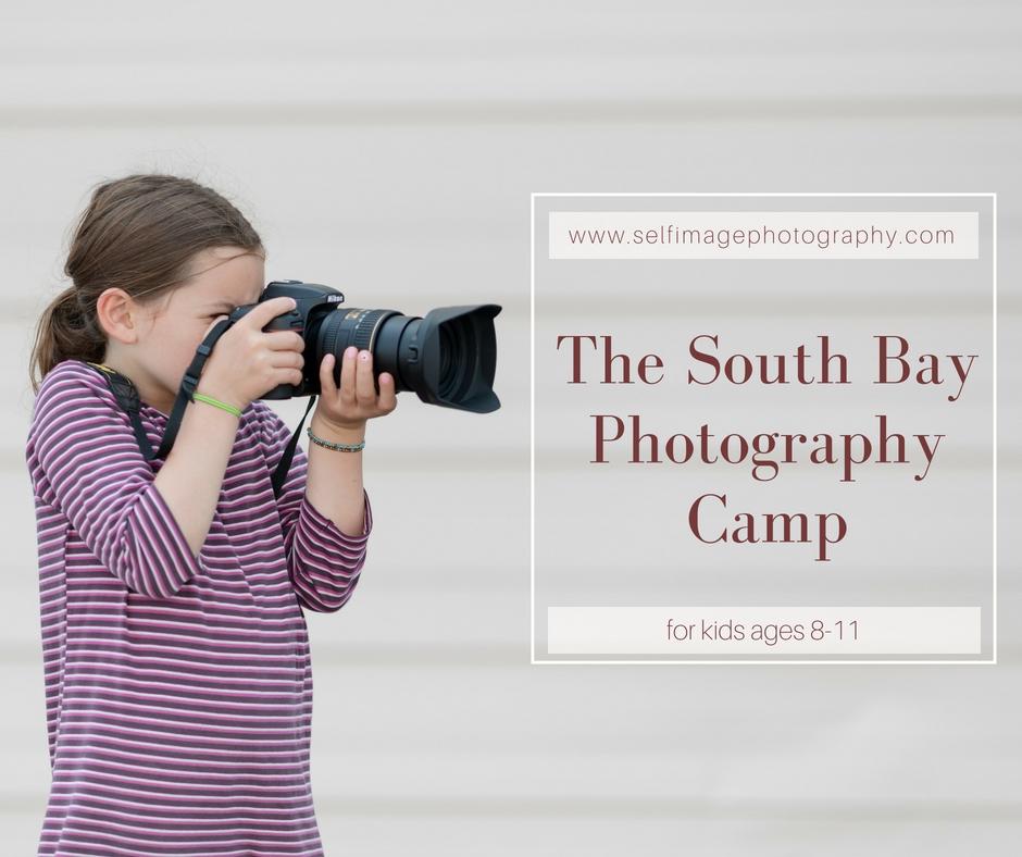 girl holding a big camera taking photos