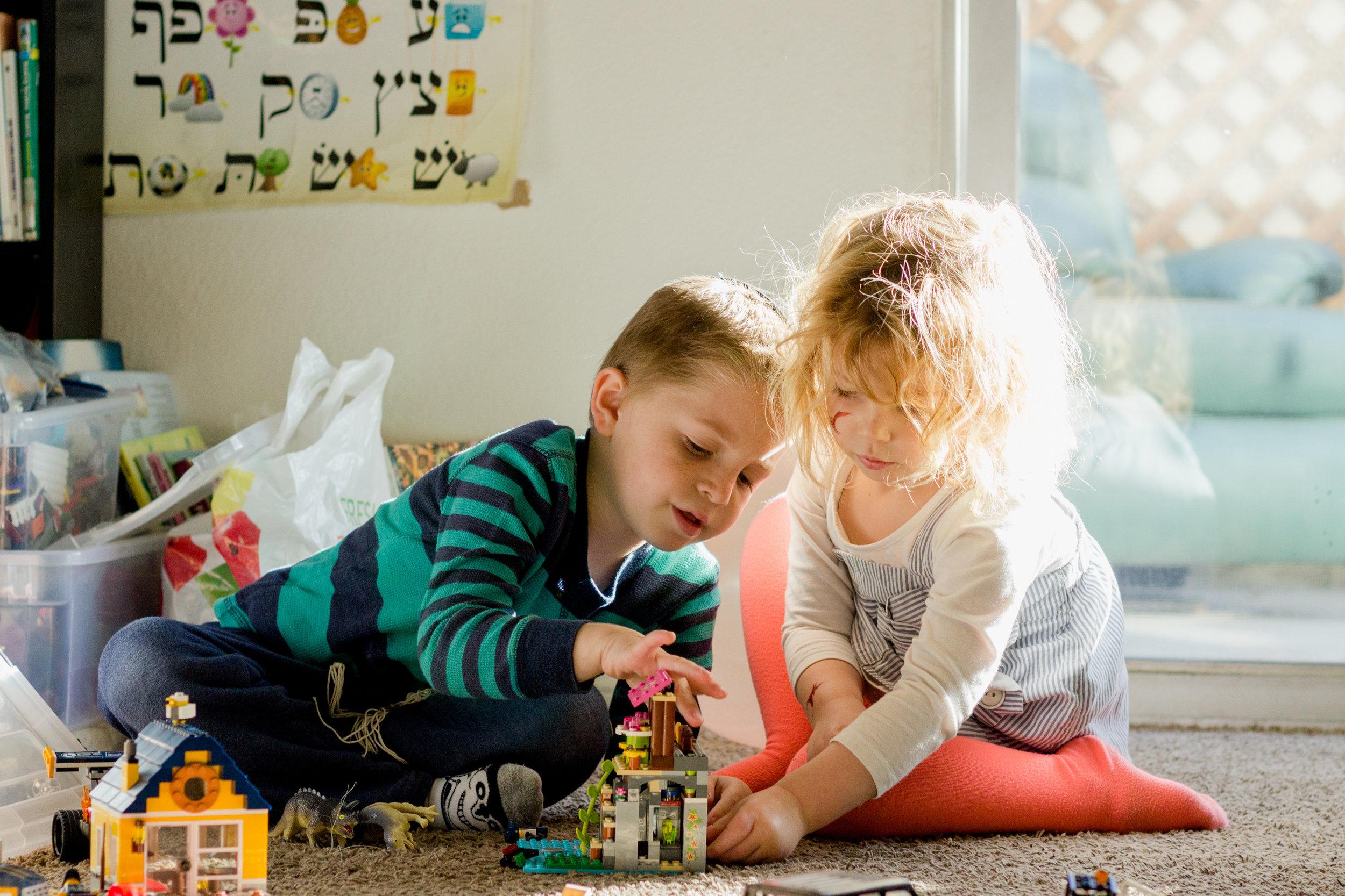 siblings playing legos