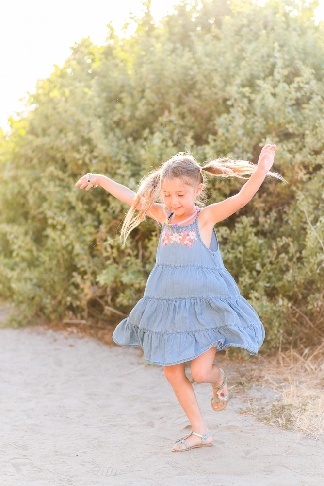 6 year old girl dancing at the beach
