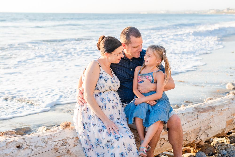 family of three at ocean