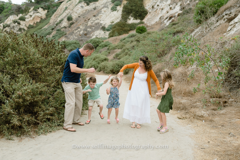 family dancing on a path