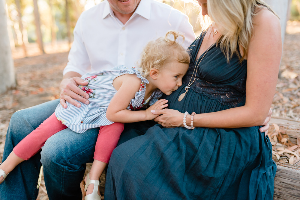 Maternity photography, little girl kissing baby brother in her mommy's tummy