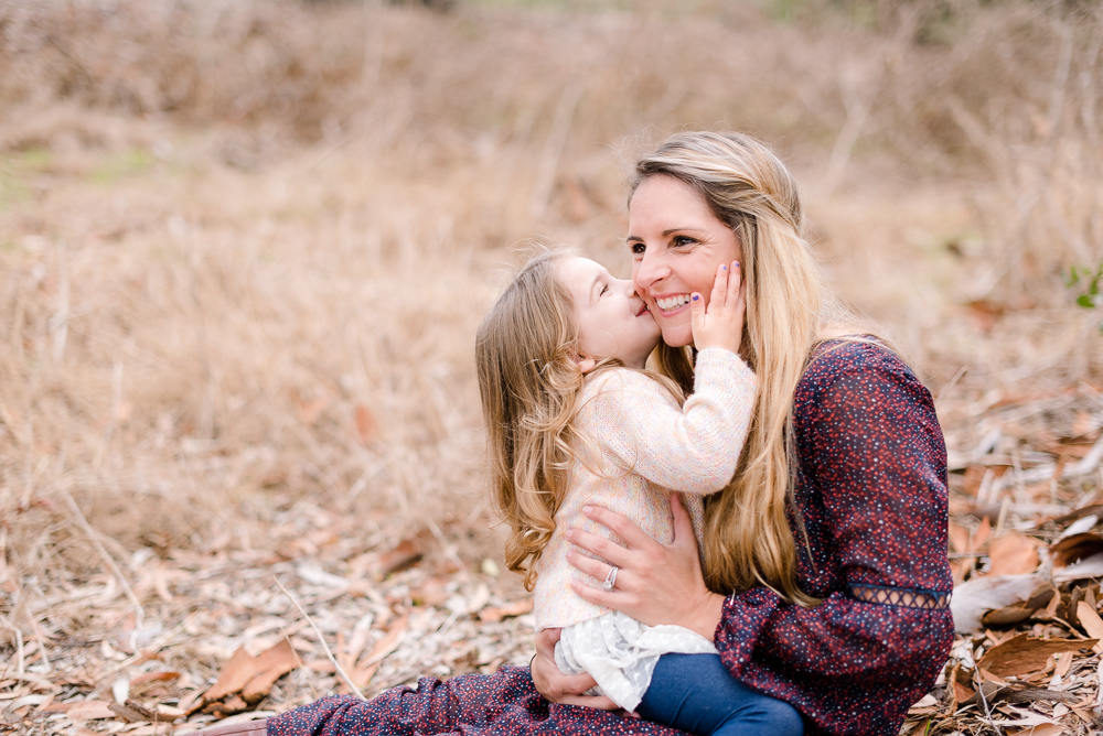family photography, little girl kissing mother on cheek