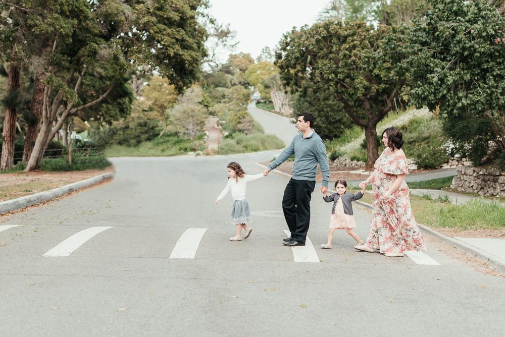 Maternity photography, family walking across the street