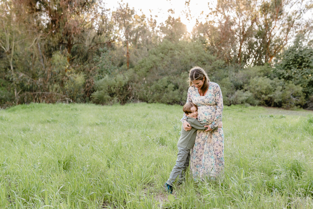 Maternity photography, little boy hugging mother