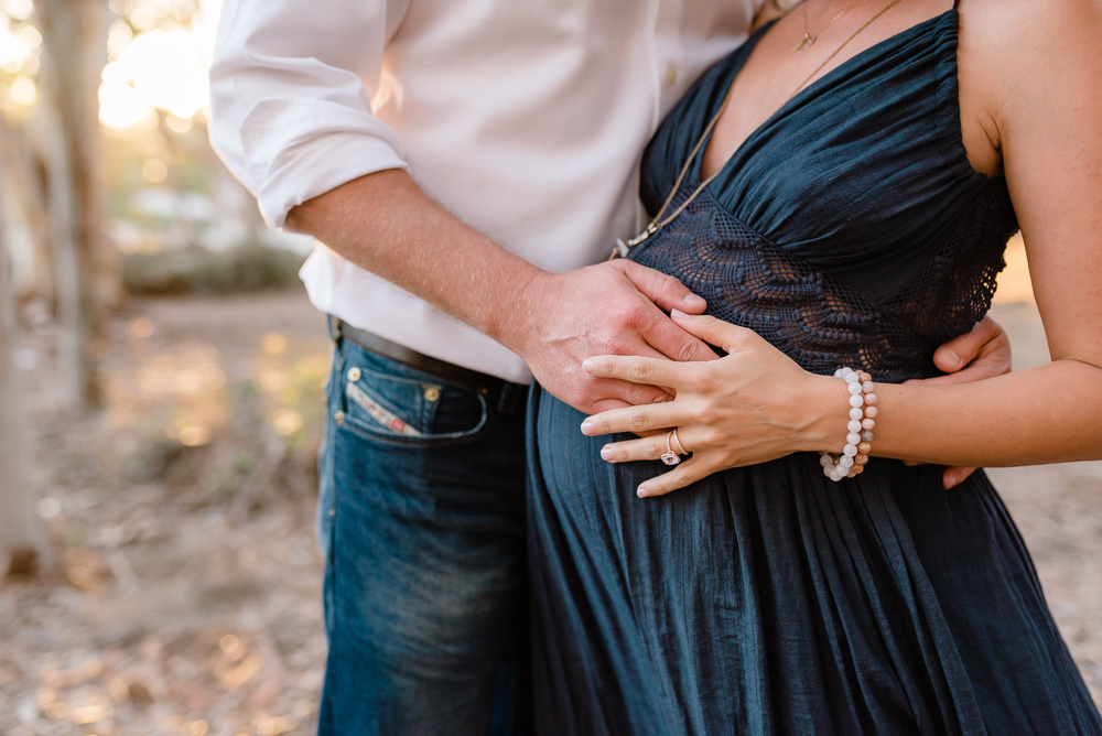 Maternity photography, man with his hand on woman's belly