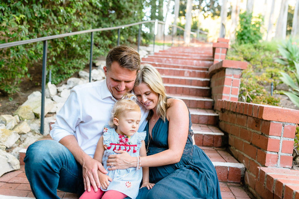 Maternity photography, family of three sitting on brick steps
