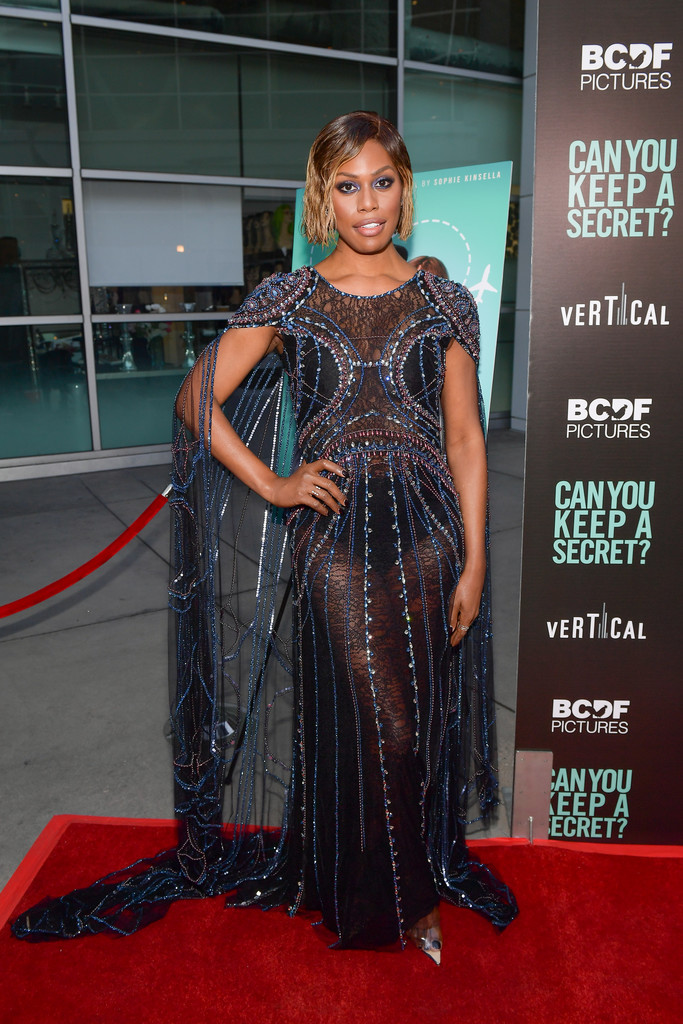 Laverne Cox wearing MARLI New York's Pyramid Asymmetrical Earrings to the 'Can You Keep A Secret' Screening in Hollywood California on August 28, 2019
