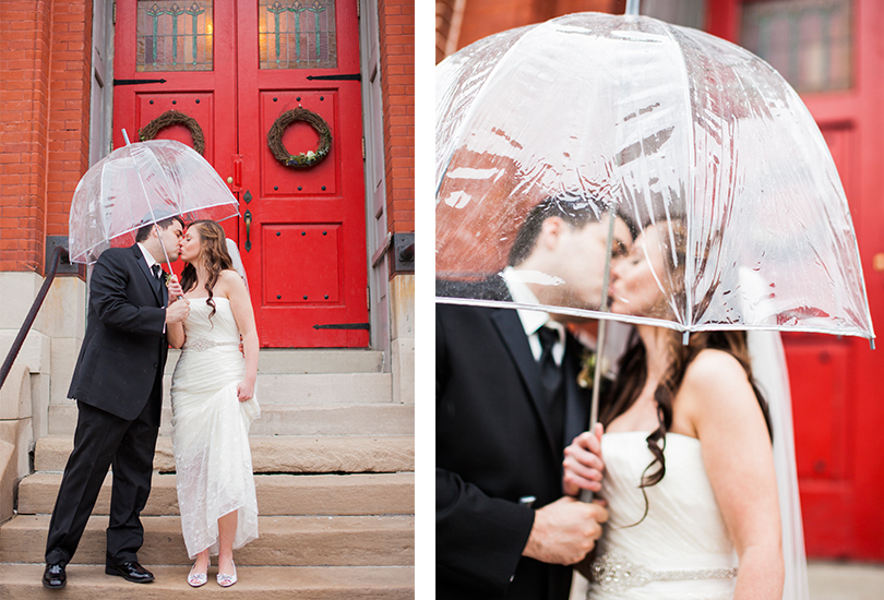 Downtown Indianapolis Sanctuary on Penn wedding reception ceremony venue couple pose on front steps red door under clear umbrella.jpg