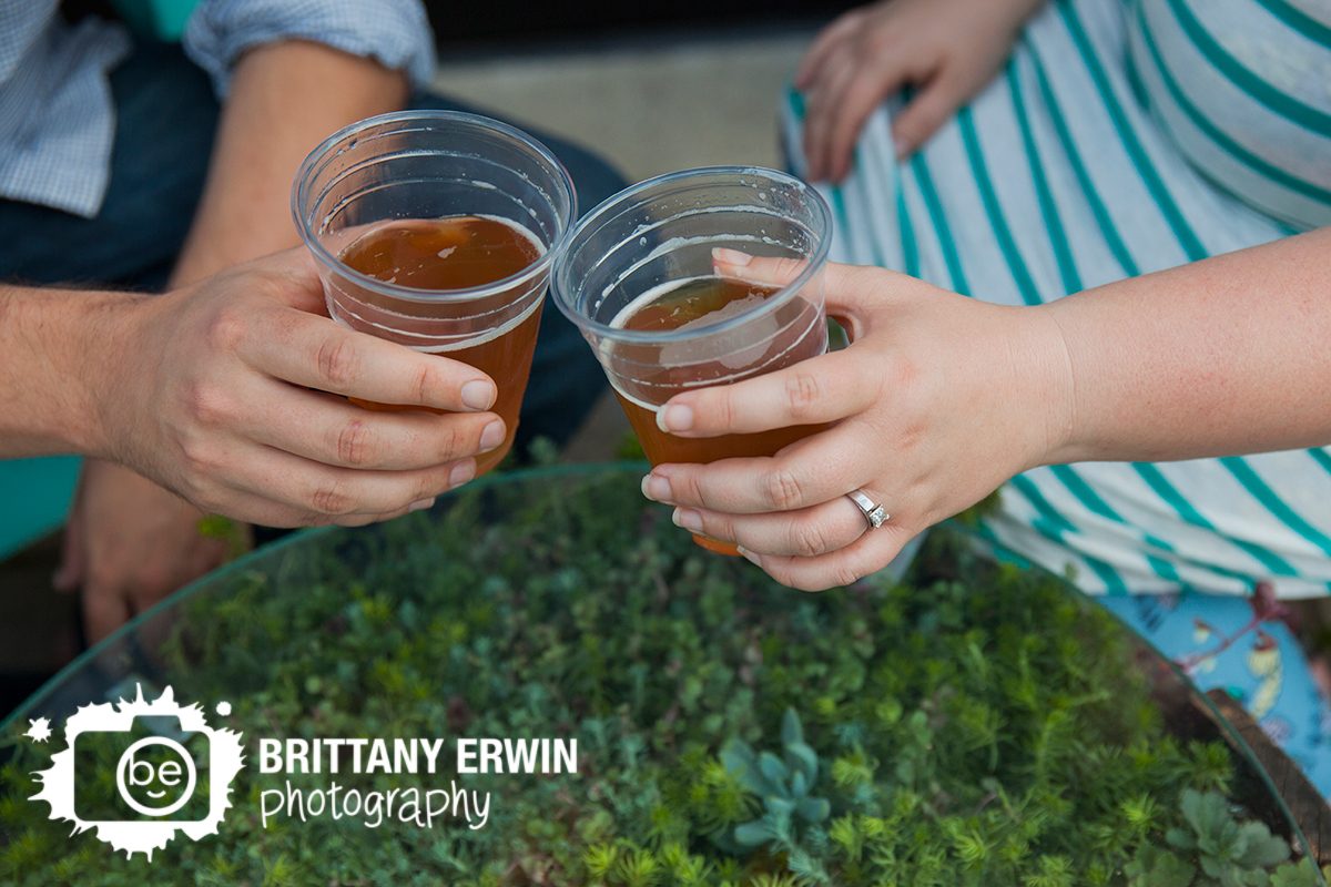 Indianapolis-engagement-portrait-photographer-plant-table-beer-toast-ring.jpg