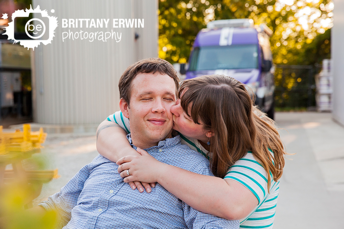 Indianapolis-engagement-portrait-brewery-photographer-cheek-kiss.jpg