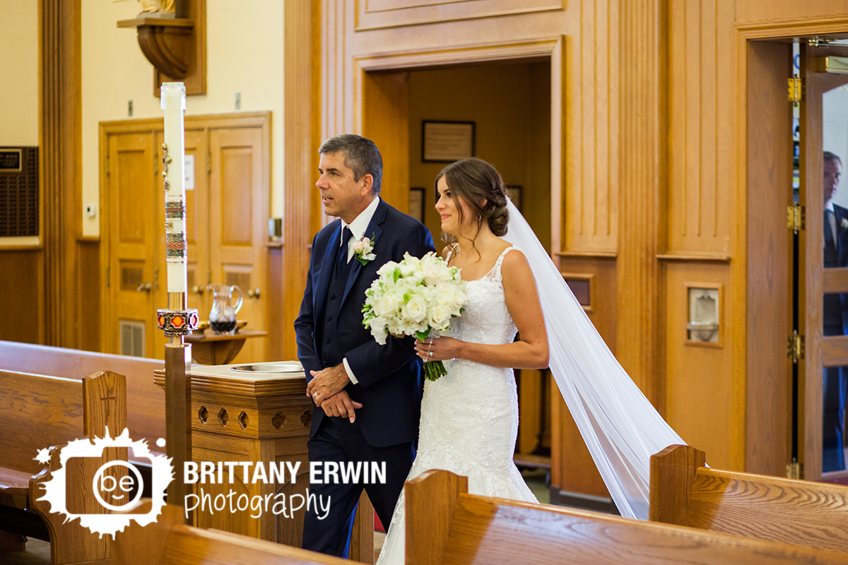 Indianapolis-wedding-ceremony-photographer-bride-with-father-walk-down-aisle-st-roch.jpg