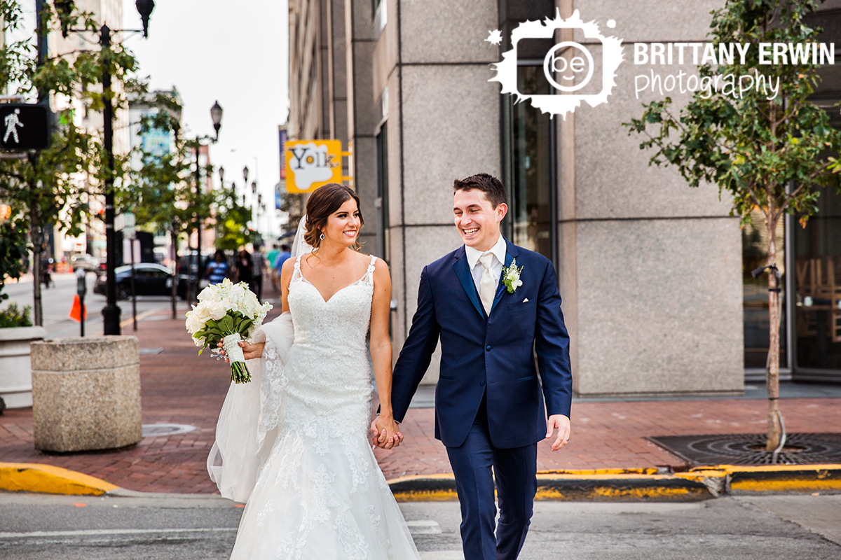 Indianapolis-wedding-photographer-urban-couple-walk-cross-street-fun-bridal-portrait.jpg