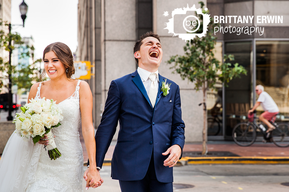 Indianapolis-downtown-wedding-photographer-urban-couple-walk-laugh-fun-bridal-portrait.jpg