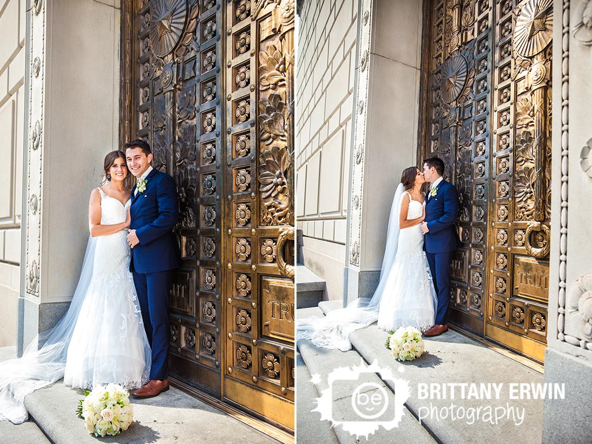 Indianapolis-world-war-memorial-wedding-photographer-bride-groom-gold-doors-bouquet.jpg
