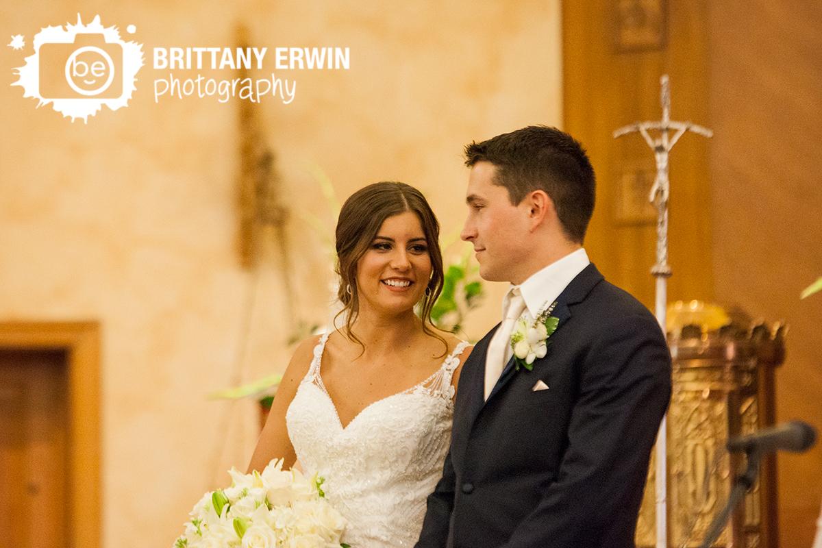 Indianapolis-catholic-church-wedding-photographer-bride-groom-at-altar.jpg