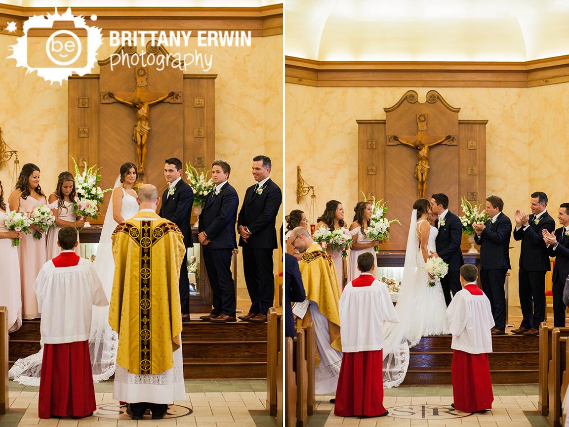 Indianapolis-catholic-wedding-photographer-st-roch-first-kiss-bride-groom.jpg