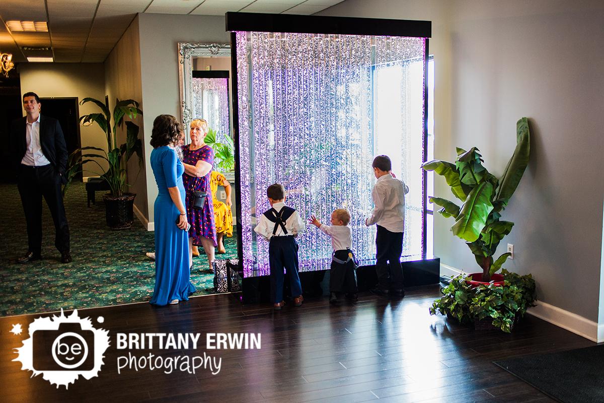 The-Palms-wedding-reception-photographer-children-play-bubble-wall.jpg