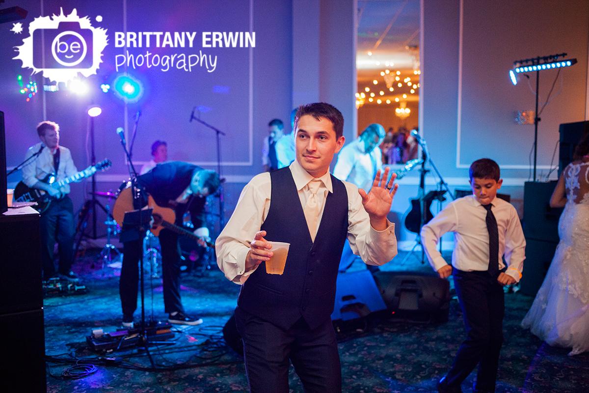 Indianapolis-wedding-photographer-groom-beer-on-dance-floor-the-palms.jpg