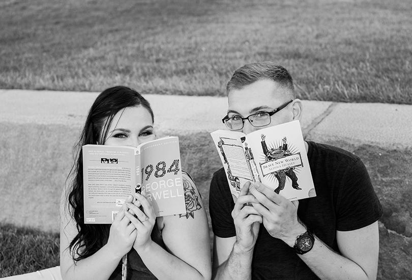 Indianapolis engagement portrait photographer couple favorite book downtown