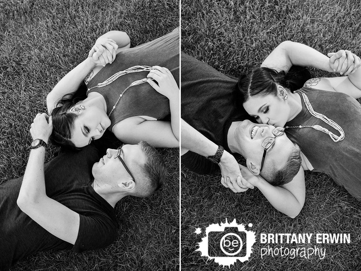 Indianapolis-engagement-portrait-photographer-couple-on-grass-cheek-kiss.jpg