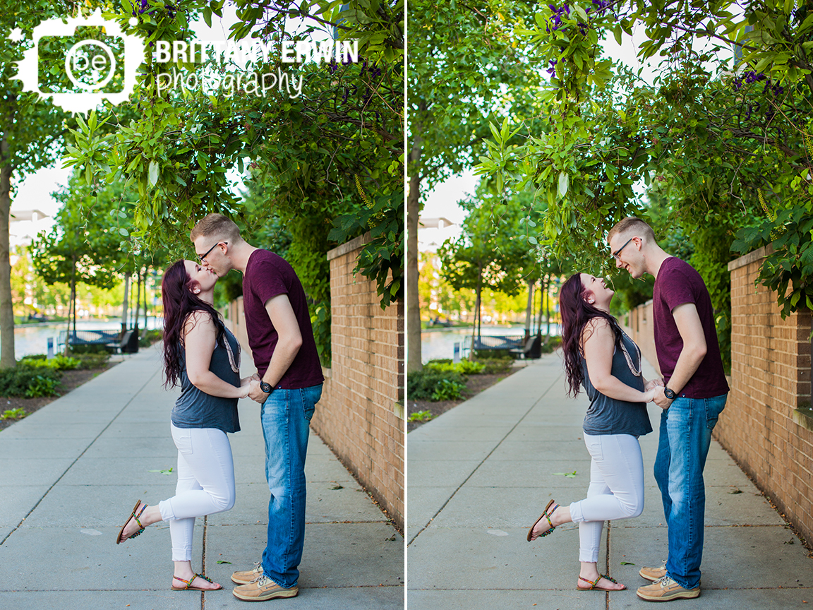 Downtown-Indianapolis-engagement-portrait-photographer-on-the-canal-kiss-laughing-fun-couple.jpg