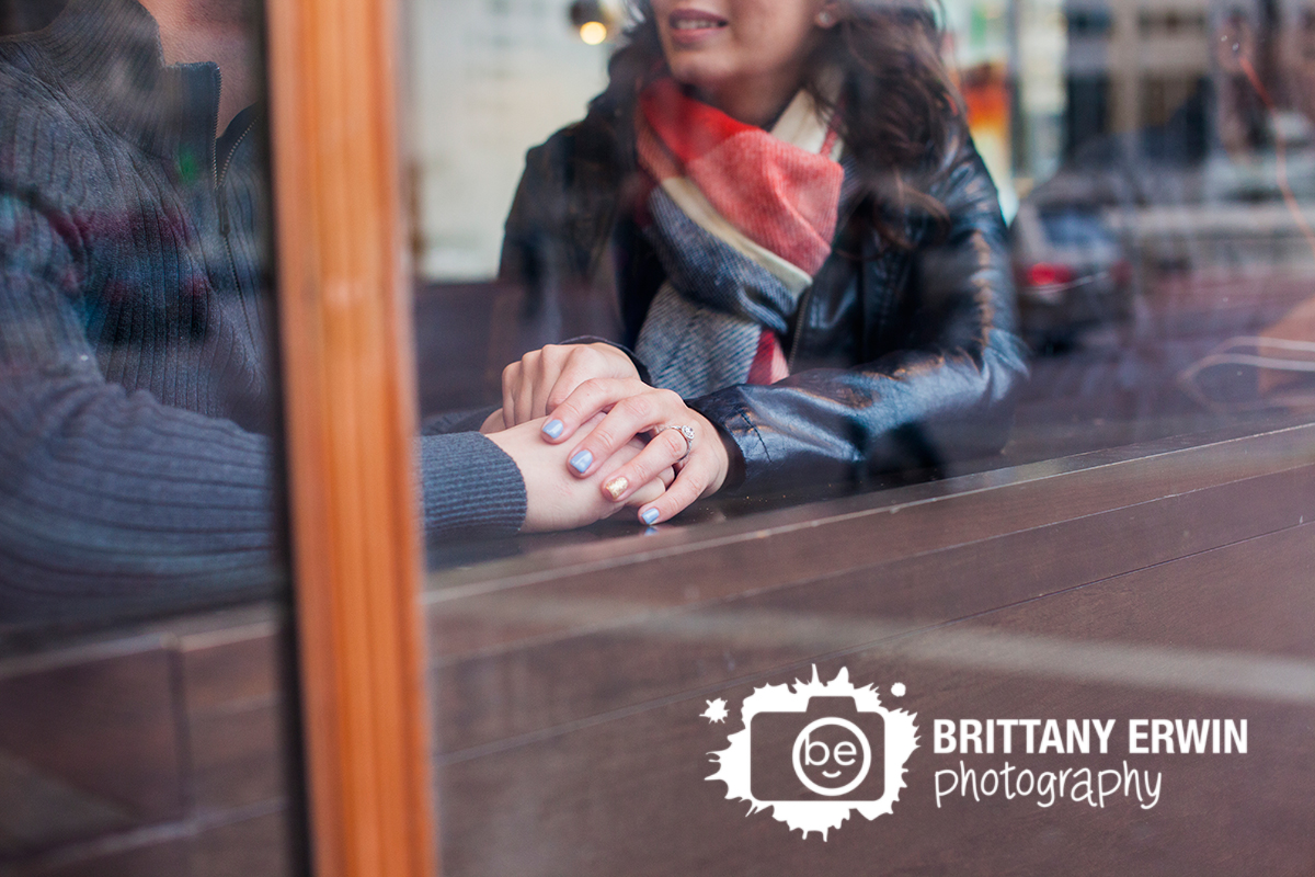 Indianapolis-engagement-portrait-photographer-couple-hold-hands-in-coffee-shop.jpg