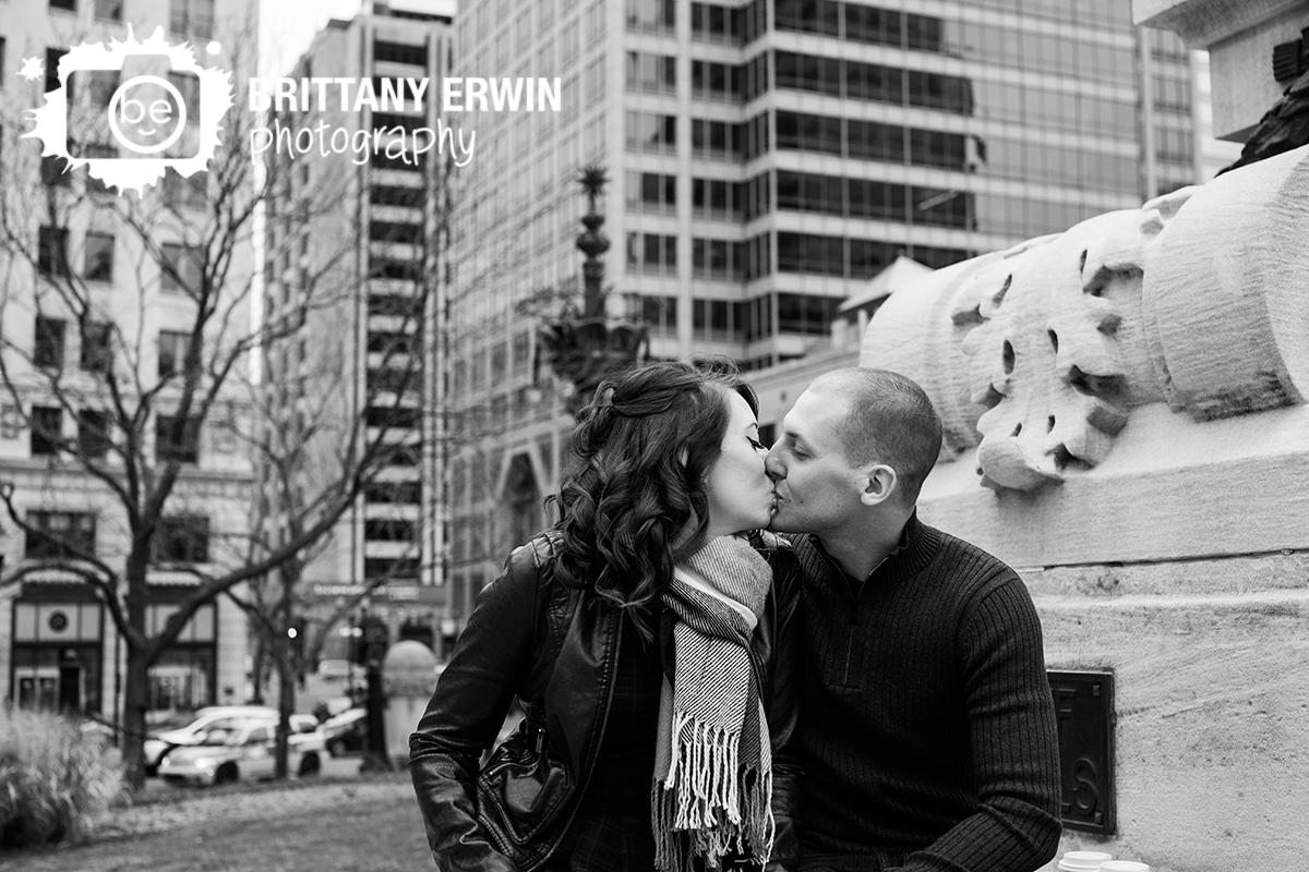 Indianapolis-engagement-portrait-photographer-downtown-monument-circle-kiss-couple.jpg