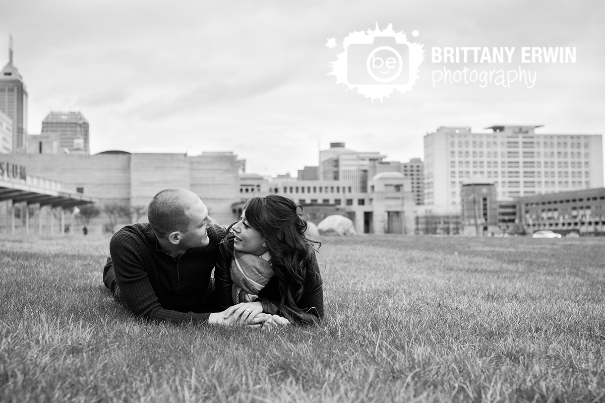 Downtown-Indianapolis-skyline-engagement-portrait-photographer-couple-in-grass.jpg