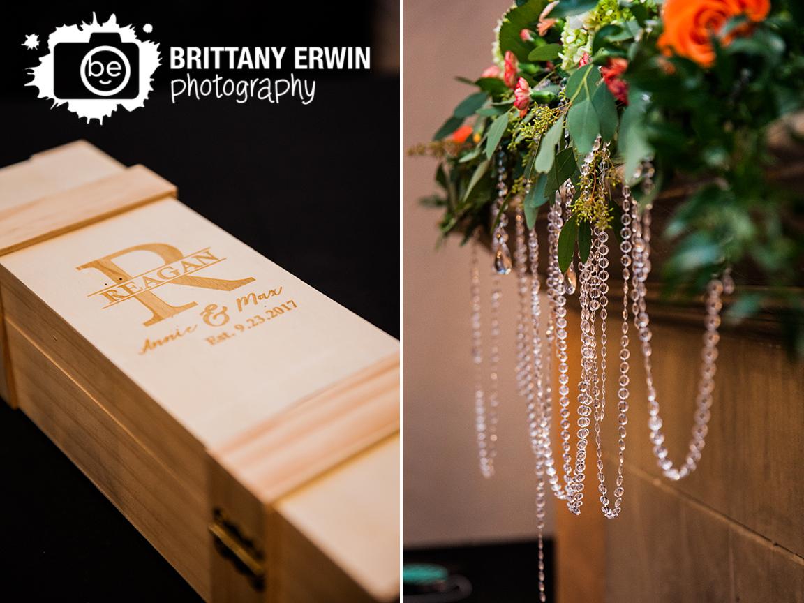 Indianapolis-wedding-ceremony-photographer-flower-piece-on-mantle-of-fireplace-wine-box.jpg
