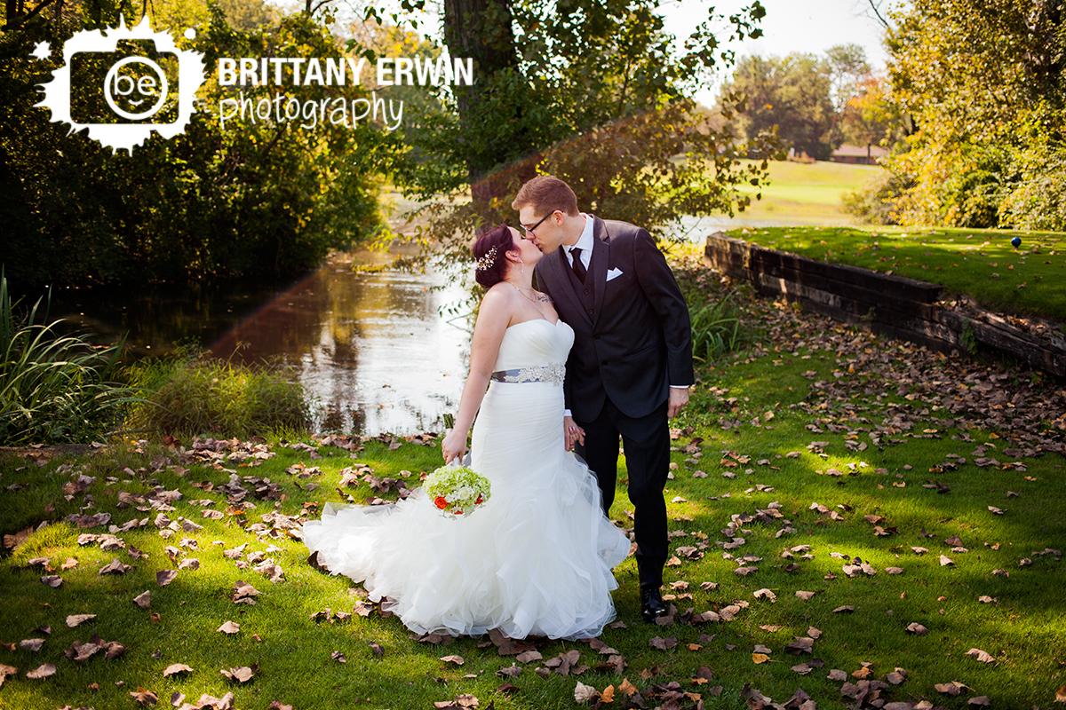 Indianapolis-wedding-photographer-couple-kiss-near-pond-Hillcrest-Country-Club.jpg