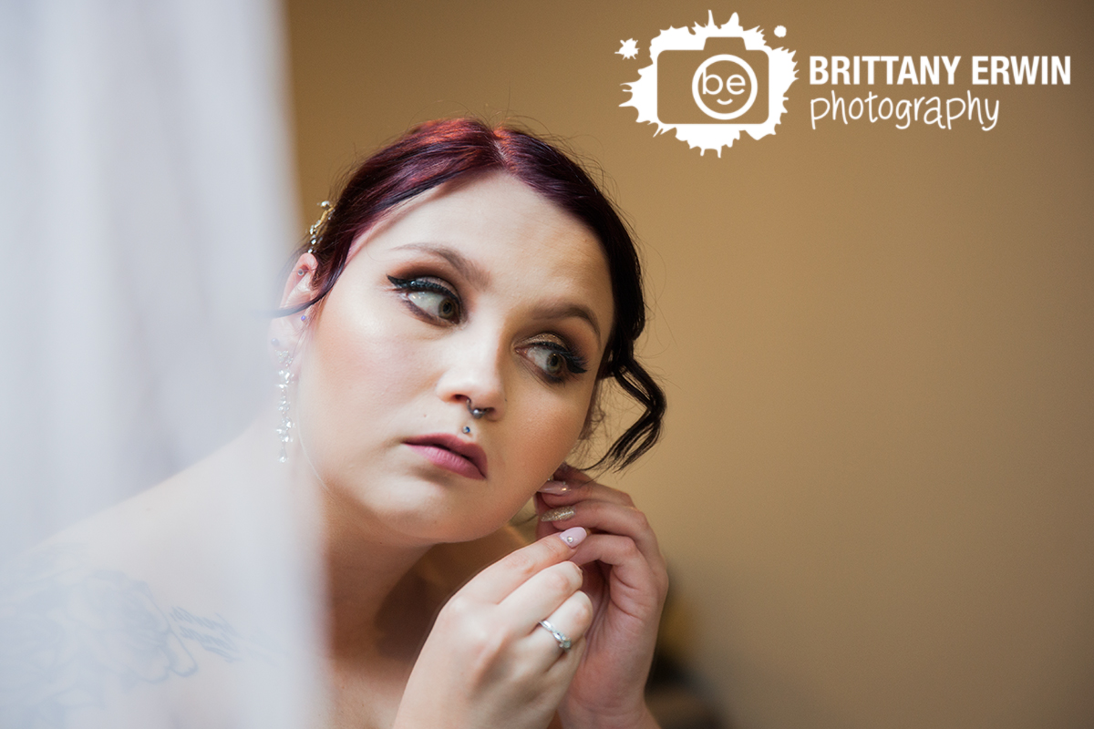 Indianapolis-wedding-photographer-hillcrest-country-club-bride-earrings-in-mirror.jpg