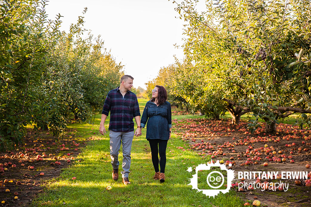 Pleasant-View-Orchard-maternity-portrait-session-photographer-couple-walking-between-apple-tree-Brittany-Erwin-Photography.jpg