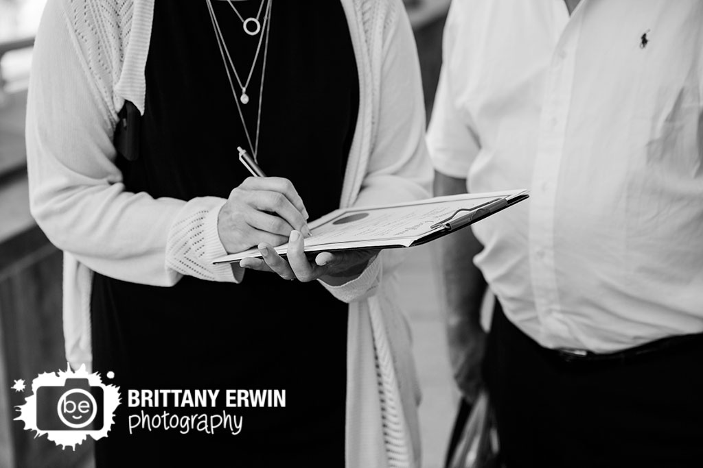 Indianapolis-elopement-photographer-witness-signing-marriage-certificate.jpg