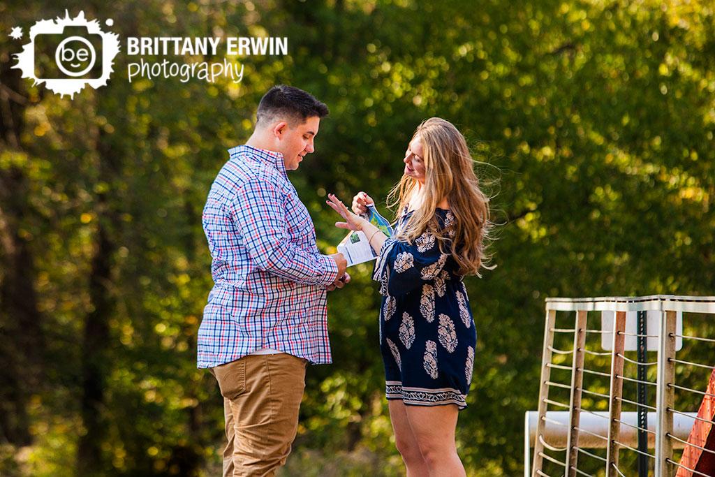 Indianapolis-proposal-photographer-she-said-yes-IMA-100-acres-park-bridge-ring.jpg