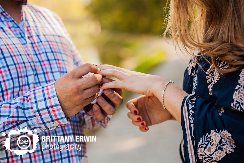Proposal-putting-on-ring-she-said-yes-IMA-photographer-100-acres-park.jpg