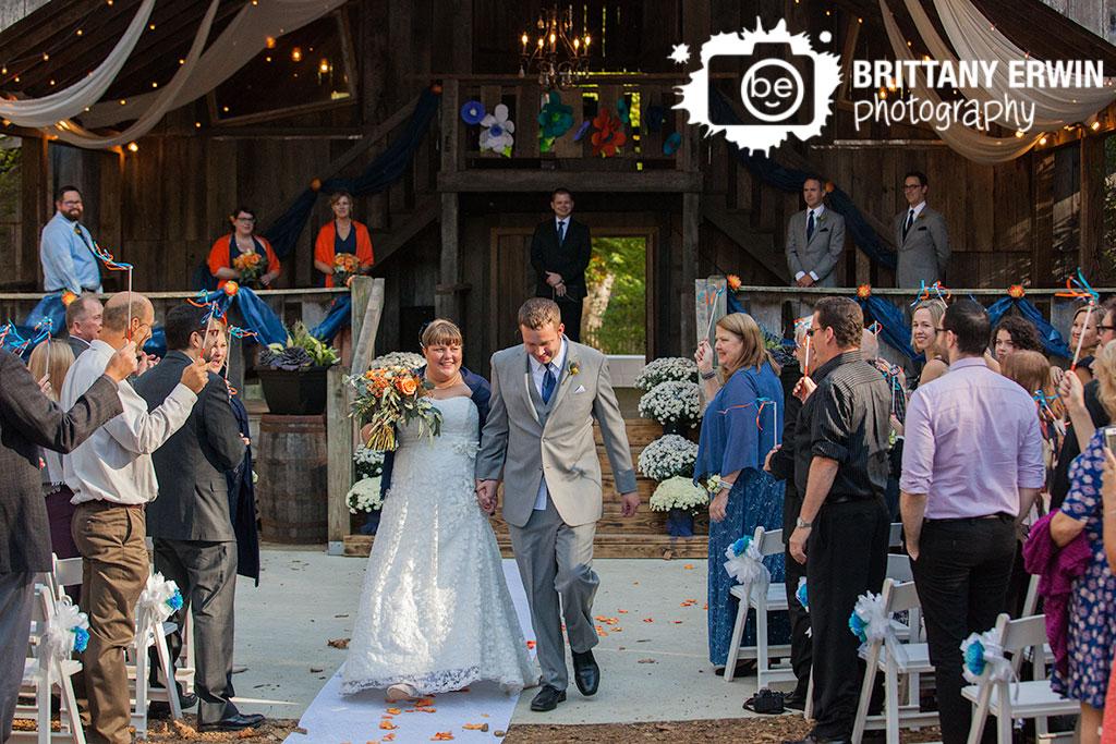 Story-Inn-barn-wedding-photographer-ceremony-bride-groom-walk-down-aisle.jpg