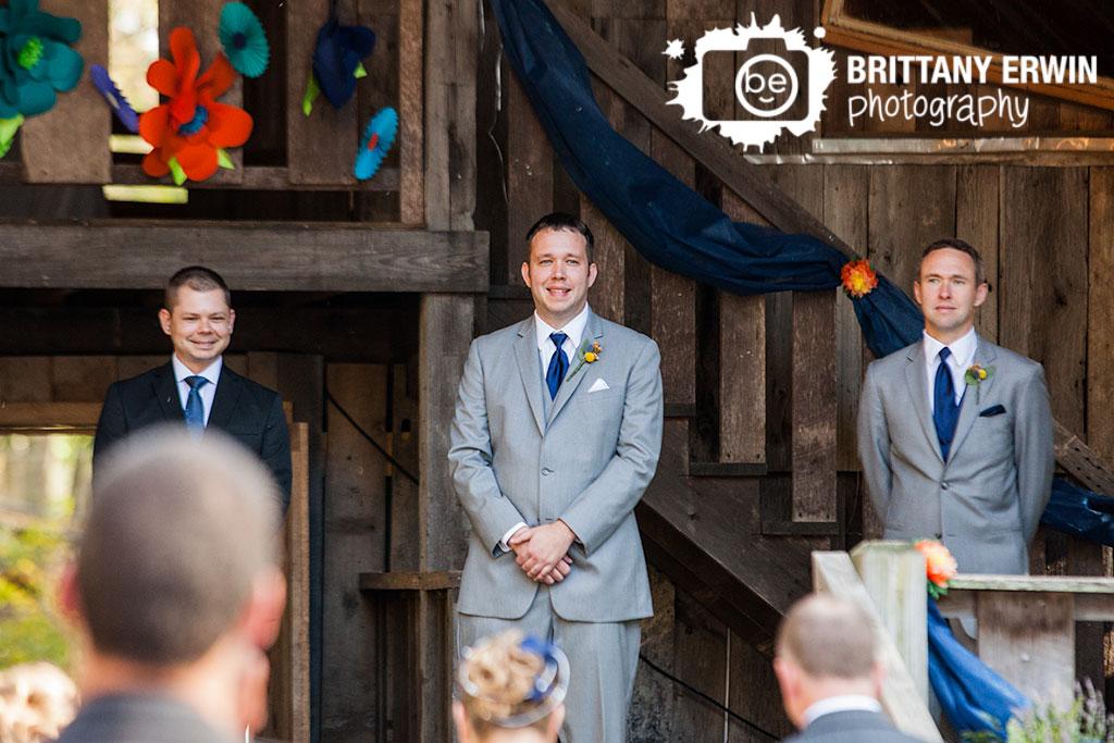Story-Inn-barn-wedding-photographer-groom-reaction-bride-walking-down-aisle.jpg