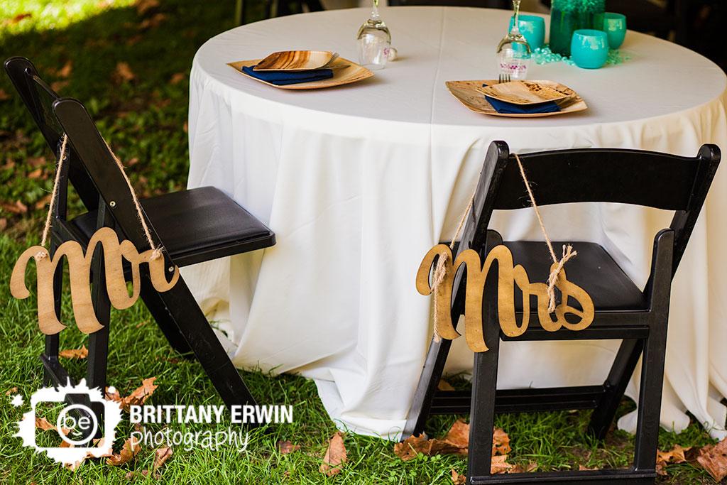 Story-Inn-wedding-photographer-reception-wood-mr-mrs-chair-signs.jpg