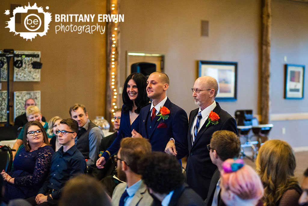 Purgatory-Golf-club-wedding-ceremony-indoor-fall-groom-parents-aisle.jpg