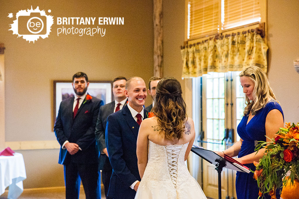 Purgatory-Golf-Club-wedding-ceremony-photographer-groom-smile-at-bride.jpg