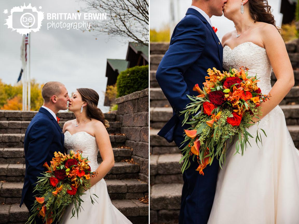 Purgatory-Golf-Club-wedding-photographer-fall-couple-kiss-bouquet-lilly-lane-florist.jpg