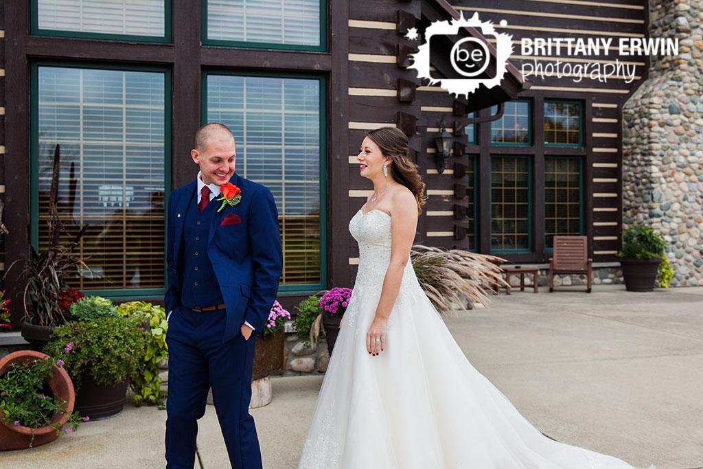Purgatory-Golf-Club-wedding-photographer-groom-see-bride-first-look-outdoor-fall.jpg
