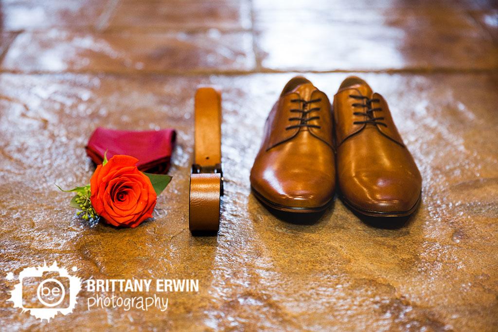 Purgatory-Golf-Club-wedding-photographer-rose-boutinnere-brown-belt-shoes-burgundy-pocket-square.jpg