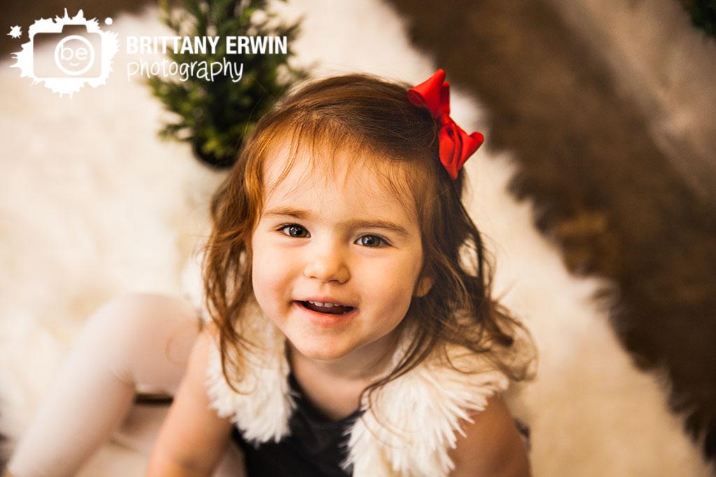 Indianapolis-portrait-studio-portrait-photographer-girl-red-hair-bow-christmas.jpg