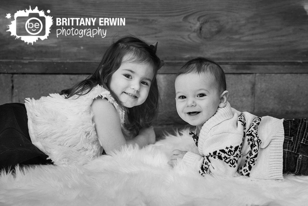 Studio-portrait-photographer-brother-sister-fur-rug-christmas-portrait.jpg