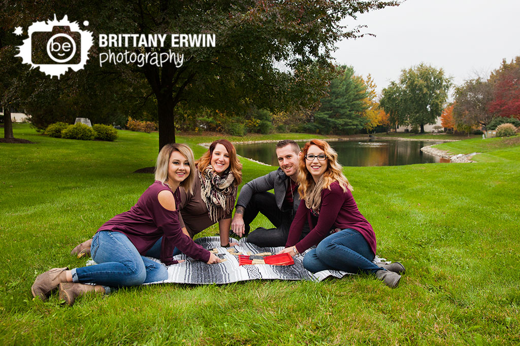 Indianapolis-family-portrait-photographer-play-dominos-by-pond-group.jpg