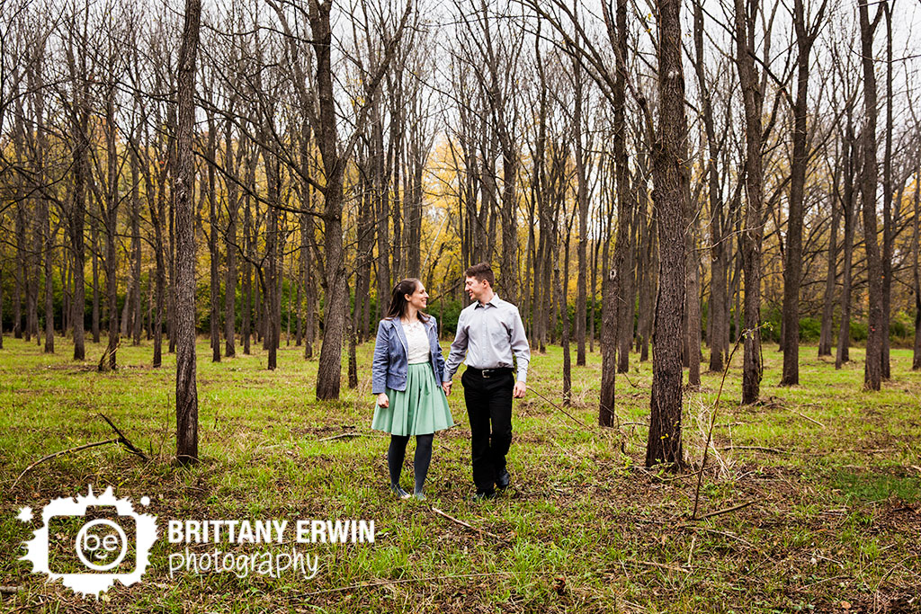 Fort-Harrison-engagement-portrait-photographer-couple-walk-walnut-trees.jpg