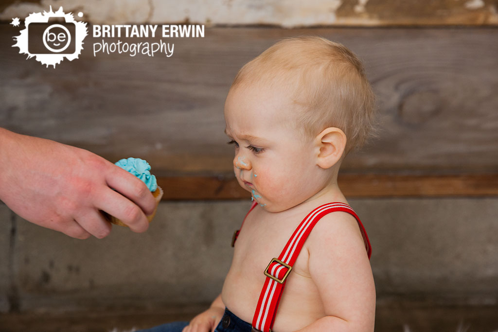 Indianapolis-studio-portrait-photographer-first-birthday-cupcake-blue-icing.jpg