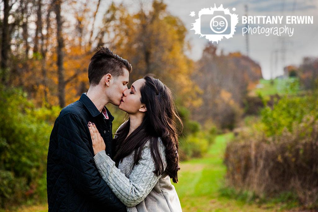 Indianapolis-fall-engagement-portrait-photographer-couple-kiss-trees.jpg